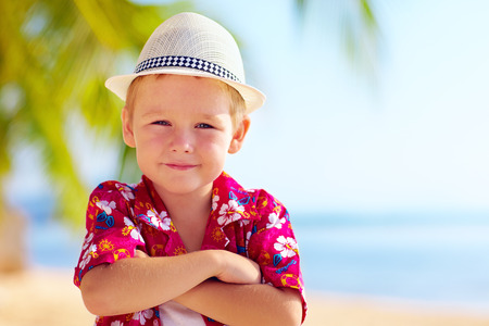 recreate: cute stylish boy on the beach Stock Photo