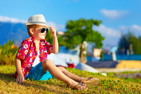 happy fashionable kid on summer meadow Stock Photo