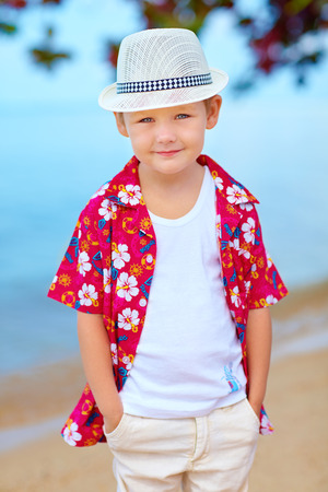 cute fashionable boy on summer beach