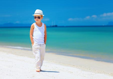 stylish boy: stylish kid boy  walking the tropical beach