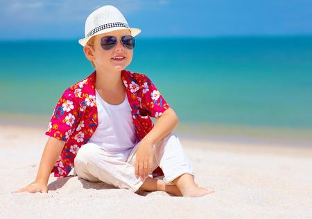 young child: happy stylish boy enjoying life on tropical beach