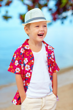 funny boy: portrait of funny laughing boy on the beach