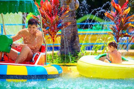 aqua park: family drive watercraft in aqua park, trying to hit each other