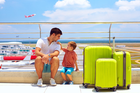 family waiting for boarding in international airport, summer vacation Stock Photo