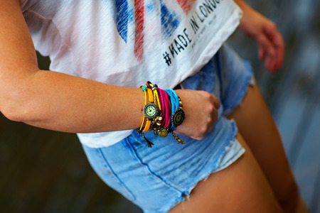bracelet: Colorful watch wristband on stylish female hand