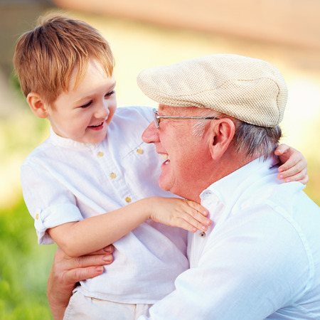 portrait of happy grandpa and grandson having fun outdoors Standard-Bild
