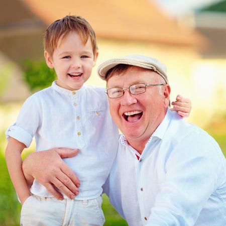 grandson: portrait of happy grandpa and grandson outdoors