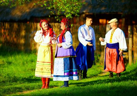 folk village: group of ukrainian people walking the village after folk festivities