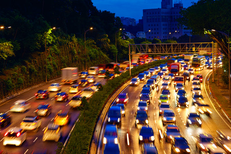 multiple lane highway: heavy traffic moving on the road in twilight, Kuala Lumpur Stock Photo