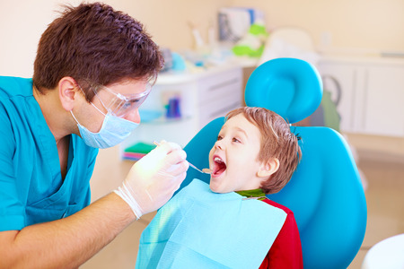 fear child: small kid patient visiting specialist in dental clinic