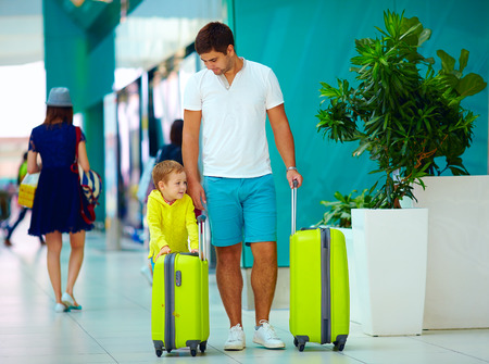 passenger aircraft: happy father and son are ready for boarding in international airport
