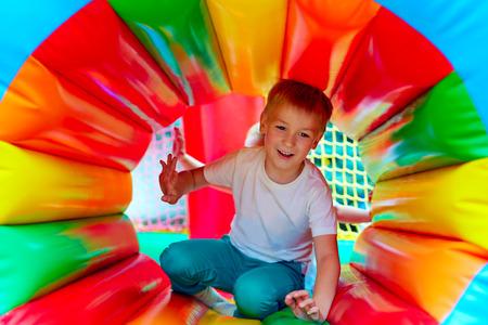 happy kid having fun on playground in kindergarten