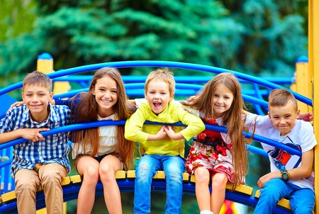 group of happy kids having fun on playground 写真素材