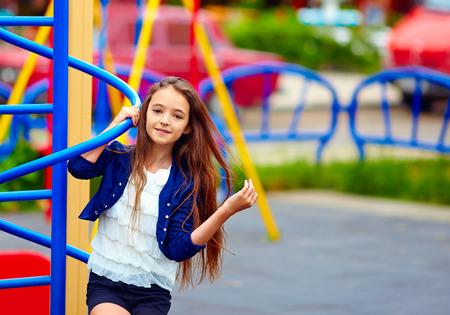 young girl smiling: beautiful teen girl on playground