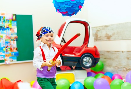 kids party: cute kid, boy dressed like pirate on playground