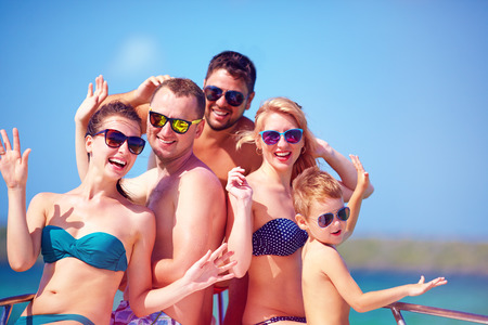 cruise: group of happy friends, family having fun on yacht, during summer vacation Stock Photo