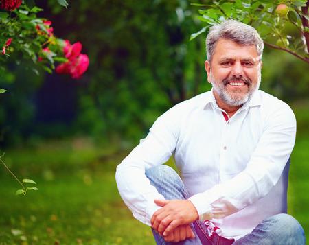 mature man: handsome mature man in summer garden Stock Photo