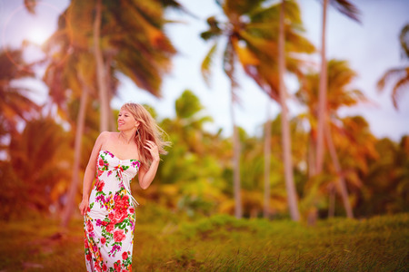 breeze: beautiful young girl in tropical palm grove, summer breeze Stock Photo