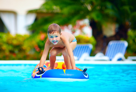 pool game: happy boy, kid having fun in swimming pool Stock Photo