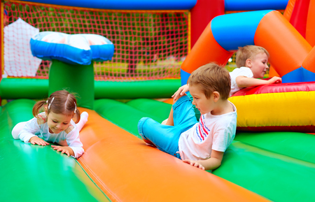 play ground: happy kids having fun on inflatable attraction playground