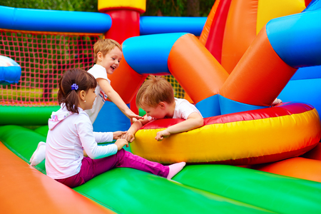 excited kids having fun on inflatable attraction playground Stock Photo