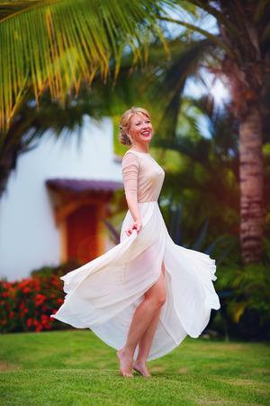 woman happy: beautiful happy elegant lady dancing in summer garden Stock Photo