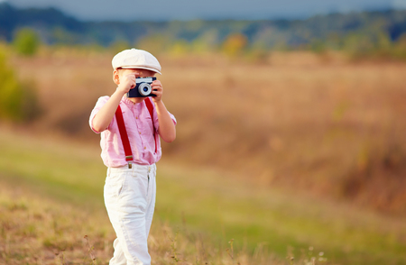 field study: cute kid shooting with old style photo camera