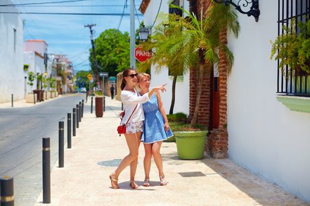santo domingo: happy young girls, tourists walking on streets in city tour, Santo Domingo Stock Photo