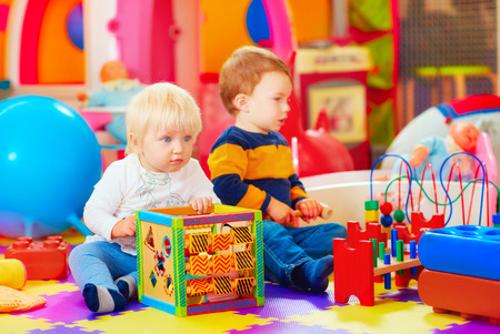 kindergarten toys: cute toddler kids in educational center, kindergarten