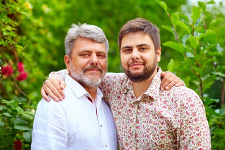 grandpa: portrait of happy father and son, that are similar in appearance