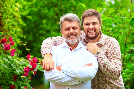 portrait of happy father and son, which are similar in appearance Stock Photo
