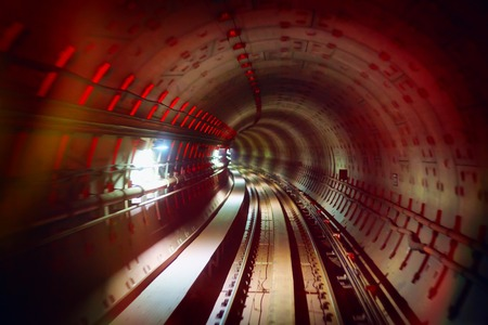 railway track: underground railway tunnel with colorful lights
