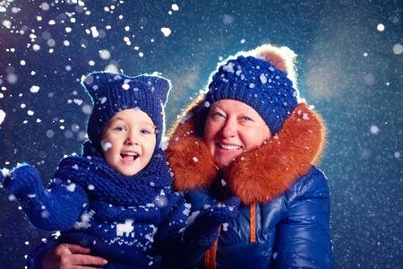 grandchild: happy grandchild and grandma having fun under the snow