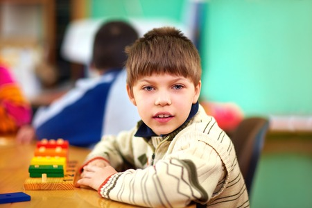 special education: cognitive development of young kid with disabilities Stock Photo