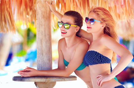 recreate: beautiful happy women, friends enjoy summer vacation on tropical beach Stock Photo