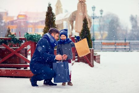 fabric bag: happy family on shopping in winter city