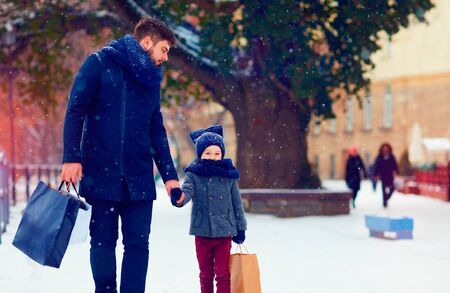 father and son walking on winter shopping Stock Photo