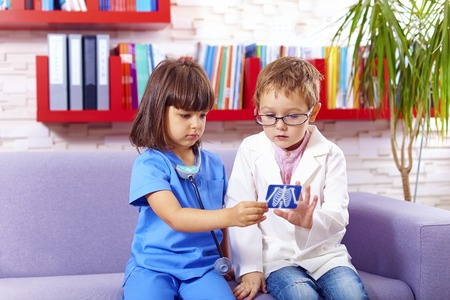 kids playing: cute kids playing doctors in office