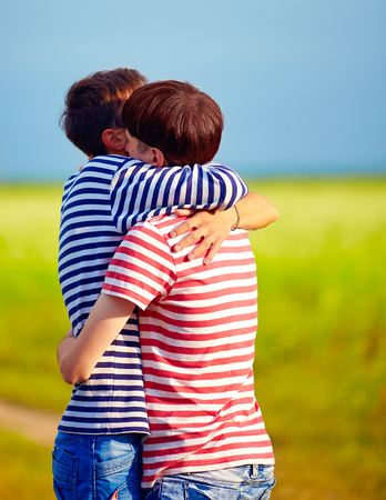 gay boy: young male couple embracing outdoors