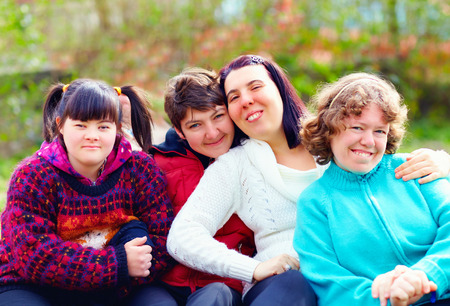 handicapped person: group of happy women with disability having fun in spring park
