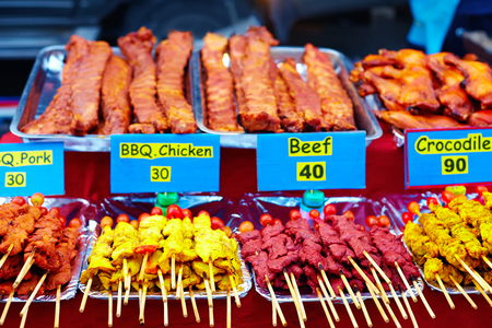 stand with different sorts of meat at street market