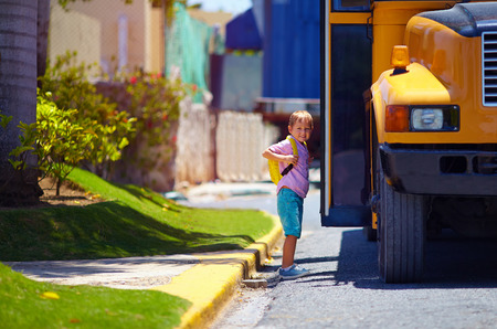 schoolbus: cute kid are getting on the bus, ready to go to school