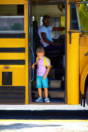 cute kid are getting off the bus, after school Archivio Fotografico