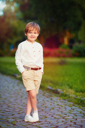 child boy: portrait of cute young fashionable boy posing outdoors