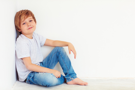 6 7 year old: handsome young boy, kid posing near the white wall