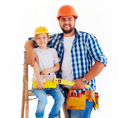 house robe: happy father and son ready to repair a house Stock Photo