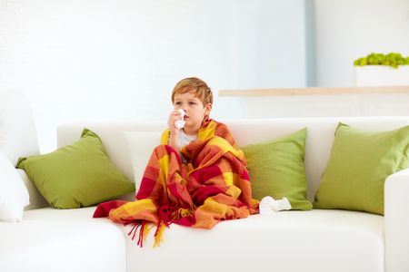 runny: sick kid with runny nose and fever heat at home