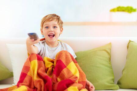 boy kid: excited boy, kid watching tv at home