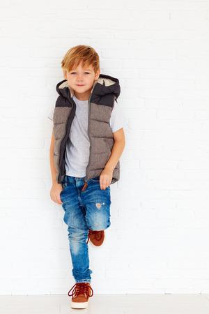 fashionable kid near the wall