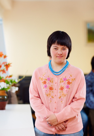 portrait of young adult woman with down's syndrome Stock Photo - 66540348